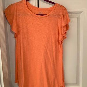 orange short sleeve shirt with sleeve ruffles